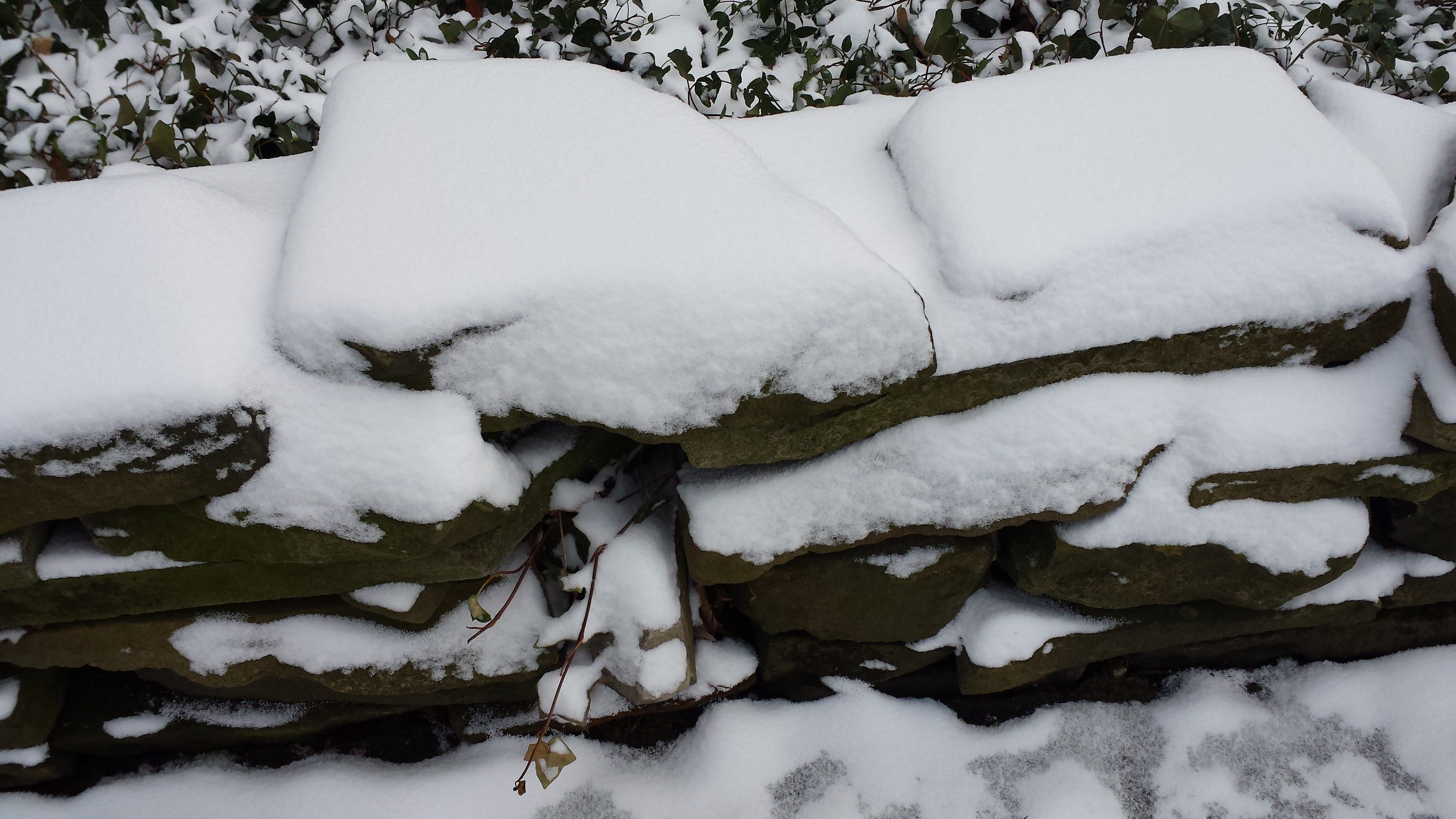 Snow-Covered Stone Wall