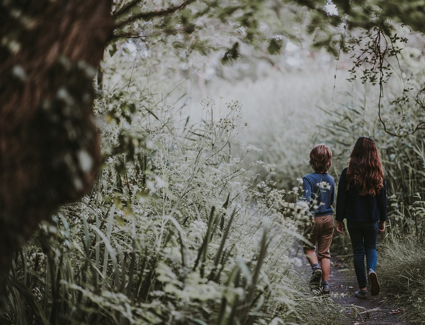 Kids outside walking - remember to keep homeschooling simple